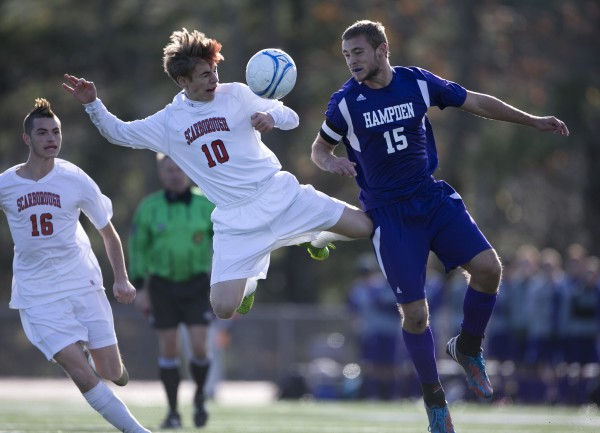 Scarborough's Noah Stracqualursi, (10)  Hampden Academy's Benjamin Foster battle for the ball in the Class A boys soccer state championship, Saturday, Nov. 9, 2013, in Bath.