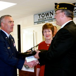 Brigadier General Gerard Bolduc, Commander of Maine Air National Guard and Senator Susan Collins present Distinguished Flying Cross with Valor to Gene Dobbins, nephew of Jerry W. Dobbins