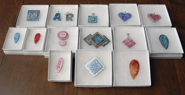 Among the mosaic eggshell jewelry designed and crafted by Sonja Twombly of Lally Broch Farm are earrings, letter jewelry, pendants, and ribbon jewelry.