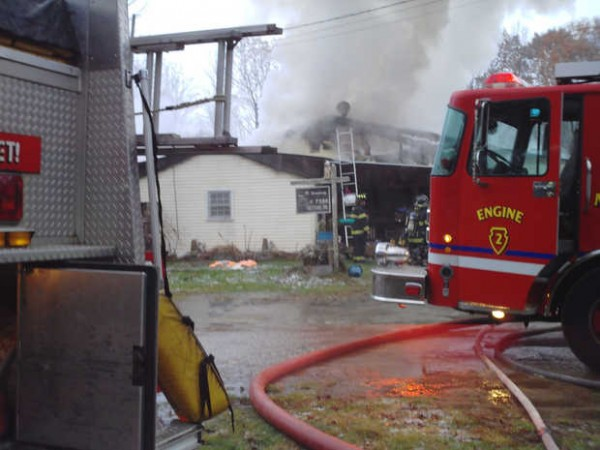 Firefighters from several towns responded to a fire that destroyed the 25 Burns Road home in Oxford early Sunday.