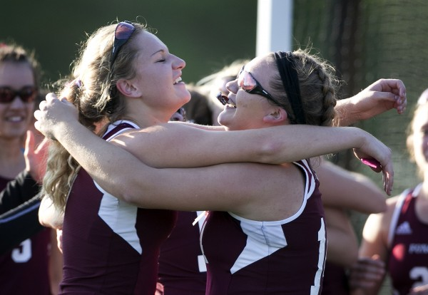 Foxcroft Academy's Julia Annis (left) and MacKenzie Coiley congratulate each other after defeating North Yarmouth Academy in the Class C field hockey state championship game Saturday, Nov. 2, 2013, in Yarmouth, Maine.
