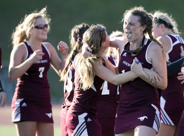 Foxcroft Academy's MacKenzie Coiley (right) celebrates with Emma Tetlow after defeating North Yarmouth Academy in the Class C field hockey state championship game Saturday, Nov. 2, 2013, in Yarmouth, Maine.