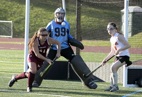 Foxcroft Academ's Abigail Simmons (left) moves in to clear a rebound off a North Yarmouth Academy shot in the final seconds to preserve the win in the Class C field hockey state championship game Saturday, Nov. 2, 2013, in Yarmouth, Maine.