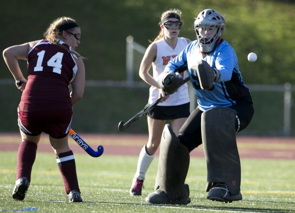 Foxcroft Academy goalie Brianna Skolfield makes a save in the final seconds to defeat North Yarmouth Academy in the Class C field hockey state championship game Saturday, Nov. 2, 2013, in Yarmouth, Maine.