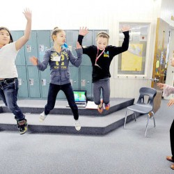 """Students from the Maine French Heritage Language Program find a creative way to learn the French song, """"Bateau Sur L'eau,"""" (""""Boat on the Water"""") at Sherwood Heights Elementary School in Auburn. French teacher Diane Pelletier-Perron works with fifth-graders, from left, Hailey Strout, Morgan Giard and Lily Vincent."""