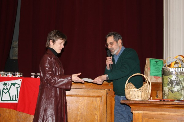PMHSKC Board President Richard Procopio thanks Maggie Lawler for her creation of bags and wallets that are sold to benefit PMHSKC's Spay/Neuter Fund