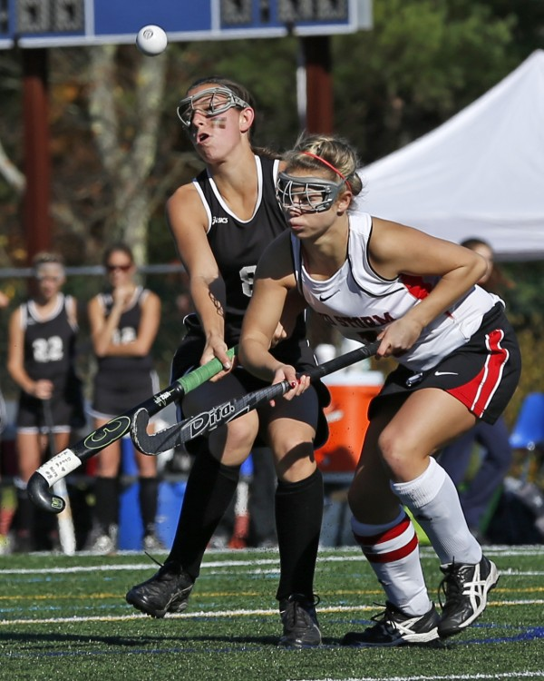 Skowhegan's Brook Michonski (left), and Scarborough's Mikaela Coombs battle for the ball in front of the Red Storm net in the second half in the Class A field hockey state championship game Saturday, Nov. 2, 2013, in Yarmouth, Maine.