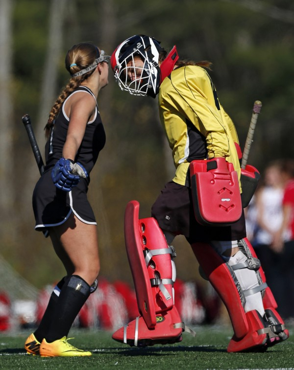 Skowhegan's Holly Lupo and goalie Leah Kruse celebrate a goal in the first half of the Class A field hockey state championship game against Scarborough on Saturday, Nov. 2, 2013, in Yarmouth, Maine.
