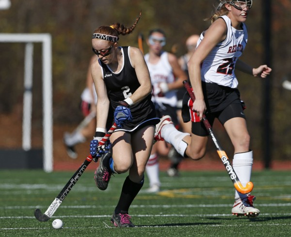 Skowhegan's Renee Wright moves the ball downfield against Scarborough in the second half of the Class A field hockey state championship game Saturday, Nov. 2, 2013, in Yarmouth, Maine.