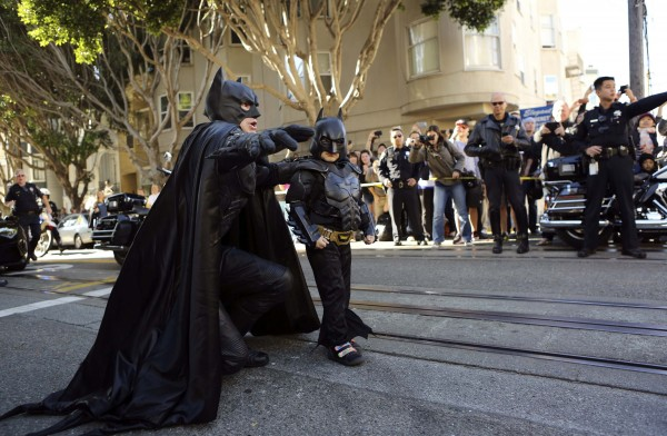 Five-year-old leukemia survivor Miles, dressed as &quotBatkid&quot, arrives with Batman to rescue a &quotwoman in distress&quot as part of a day arranged by the Make-A-Wish Foundation in San Francisco, California November 15, 2013. The young cancer survivor was treated to various super hero scenarios including receiving a commendation at San Francisco City Hall.