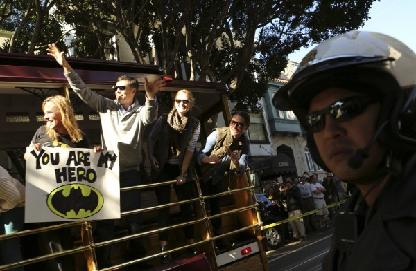 Fans of five-year-old leukemia survivor Miles, aka &quotBatkid,&quot cheer as part of a day arranged by the Make-A-Wish Foundation in San Francisco, California Nov. 15, 2013. The young cancer survivor was treated to various super hero scenarios including receiving a commendation at San Francisco City Hall.