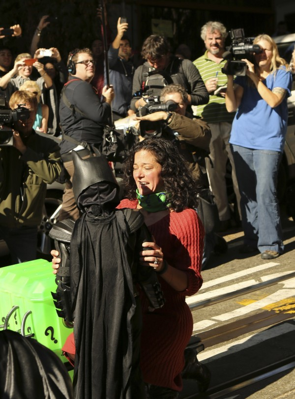 Five-year-old leukemia survivor Miles dressed as &quotBatkid&quot is hugged after rescuing a woman in distress as part of a day arranged by the Make-A-Wish Foundation in San Francisco, Calif., Nov. 15, 2013. The young cancer survivor was treated to various super hero scenarios including receiving a commendation at San Francisco City Hall.