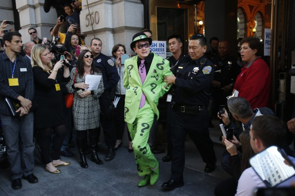 A man dressed as the Riddler is taken away by a San Francisco police officer after being apprehended by five-year-old leukemia survivor Miles dressed as &quotBatkid&quot (not pictured) as part of a day arranged by the Make-A-Wish Foundation in San Francisco, Calif., Nov. 15, 2013.