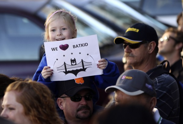 Kayla Fry holds a sign as she waits to see five-year-old leukemia survivor Miles, aka &quotBatkid&quot, as part of a day arranged by the Make-A-Wish Foundation in San Francisco, Calif., Nov. 15, 2013.