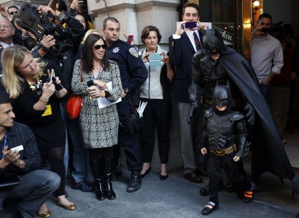 Five-year-old leukemia survivor Miles dressed as &quotBatkid&quot and a man dressed as Batman leave a bank after they apprehended the &quotRiddler&quot as part of a day arranged by the Make-A-Wish Foundation in San Francisco, Calif., Nov. 15, 2013. The young cancer survivor was treated to various super hero scenarios including receiving a commendation at San Francisco City Hall.