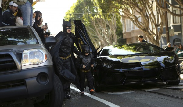 Five-year-old leukemia survivor Miles dressed as &quotBatkid&quot arrives with a man dressed as Batman to rescue a woman in distress as part of a day arranged by the Make-A-Wish Foundation in San Francisco, Calif., Nov. 15, 2013.