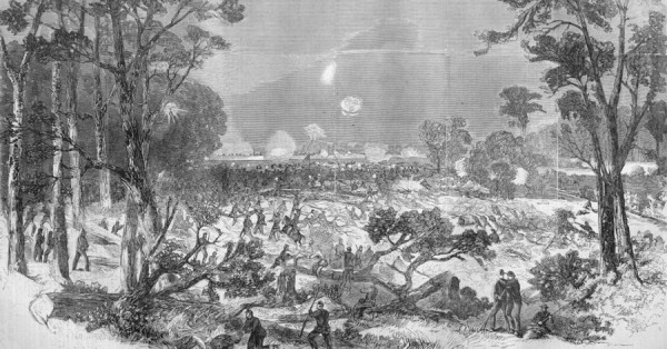 Working their way through trees felled by Confederates, Union infantrymen attack the Confederate fortifications at Port Hudson, La. in late spring 1863. A few Maine regiments participated in the siege, and many Maine men died at Port Hudson from disease or their wounds.