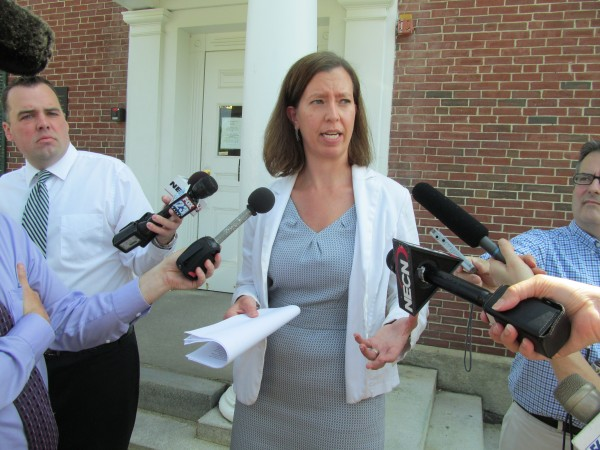 Defense attorney Sarah Churchill, who represented Kennebunk prostitute Alexis Wright in court, tells reporters Friday morning outside the courthouse about Wright's history of sexual abuse at the hands of her father. Wright was sentenced to 10 months in jail Friday and ordered to pay $58,000 in fines and restitution.