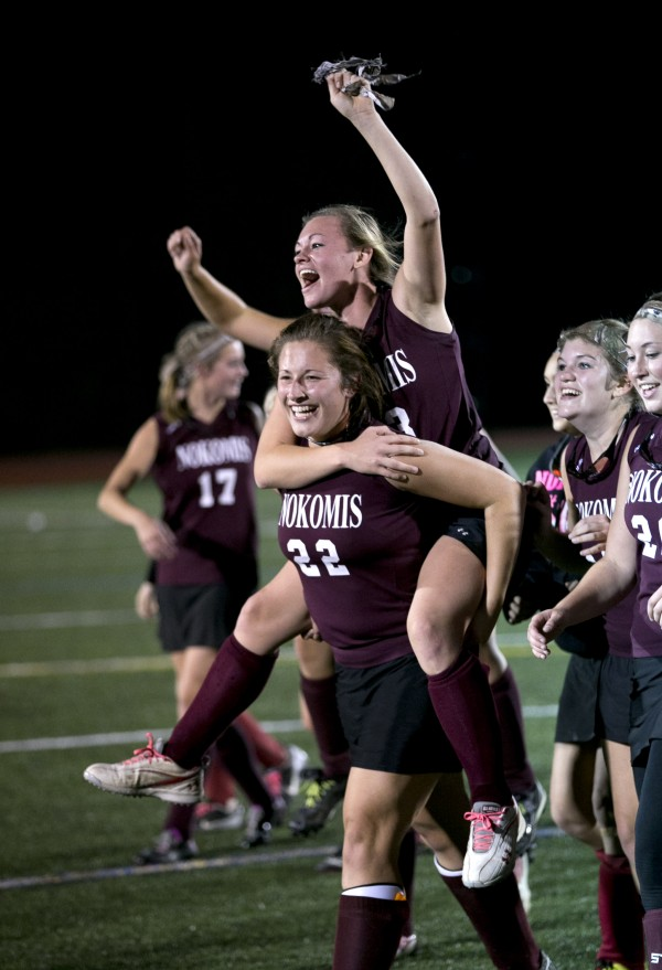 Nokomis' Taylor Shaw gets a ride from Mikayla Charters after defeating York in the Class B field hockey state championship game Saturday, Nov. 2, 2013, in Yarmouth, Maine.