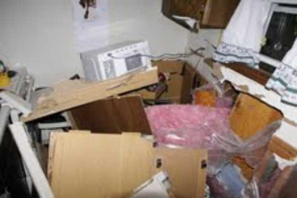 Police say that the tenant initially believed her refrigerator had blown up when she came into the kitchen and saw the damage.
