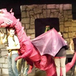 Dragon is being operated in this photo by Garret Carter (also playing the role of Lord Farquaad).