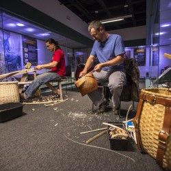 Gabe Frey, left, and Jeremy Frey make baskets during a recent demonstration at the Hudson Museum at the University of Maine. University of Maine photo