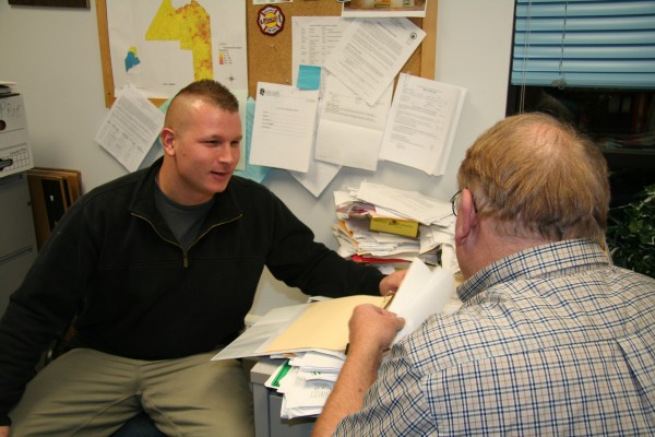 UMFK student and Air Guard member Bryan Piaseczny talks with his academic adviser Tony Enerva about his upcoming internship while on deployment in Afghanistan.