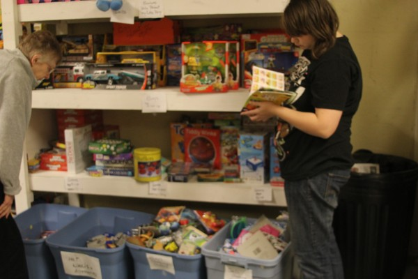 Lucille MacDonald and Angie Grindle organize sort through toys a the Emmaus House. Families from the area will come pick up boxes with age-appropriate toys for children as part of the shelter's Christmas Adopt a Family program.
