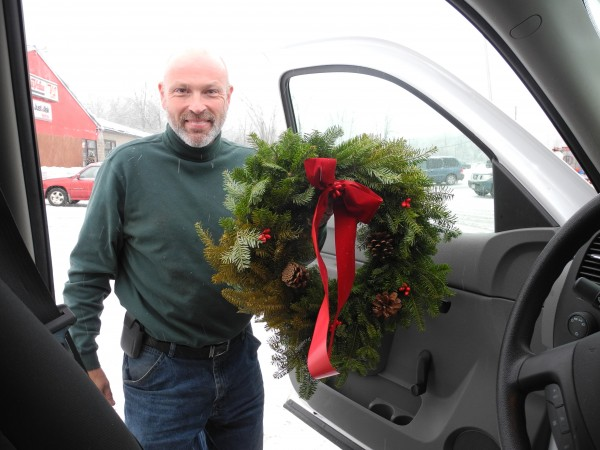 Bob Senter of Central Maine Power shows one of the 50 wreaths a local woman gave to the line workers on Thursday. &quotThat was special,&quot he said.