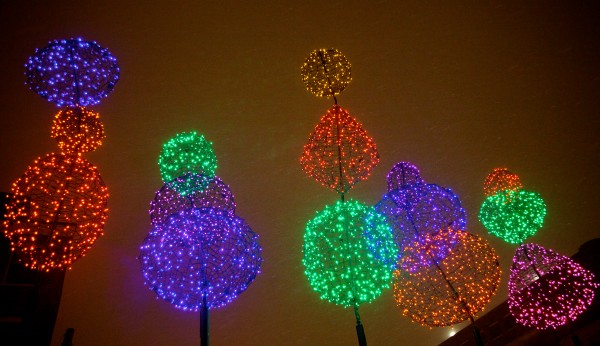 Fanciful light creations stand in the falling snow in Portland's Old Port early Sunday morning.