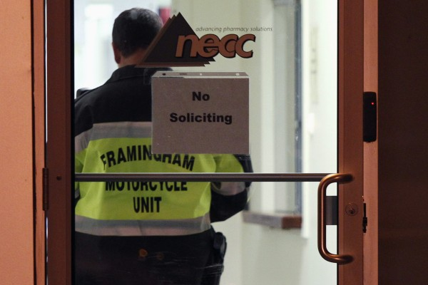 A Framingham Motorcycle Unit officer stands by while federal agents search New England Compounding Center in Framingham, Massachusetts in this October 16, 2012 file photo. The deadly outbreak of fungal meningitis tied to tainted steroid medications from the Massachusetts company expanded to 18 states on Thursday with South Carolina reporting its first probable case of the disease.