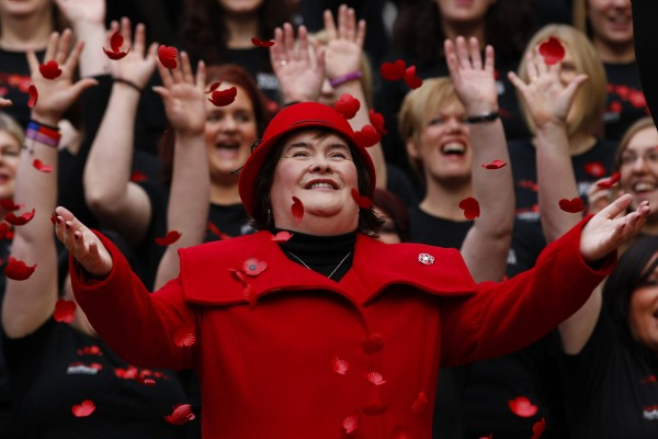 Singer Susan Boyle smiles as poppy's fall over her at a photocall during the launch of the Poppy Scotland appeal in Glasgow, Scotland October 24, 2012.