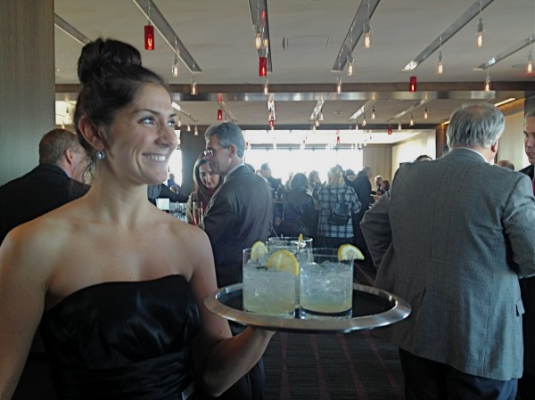 A waitress at the newly renovated Top of the East welcomes guests Thursday.
