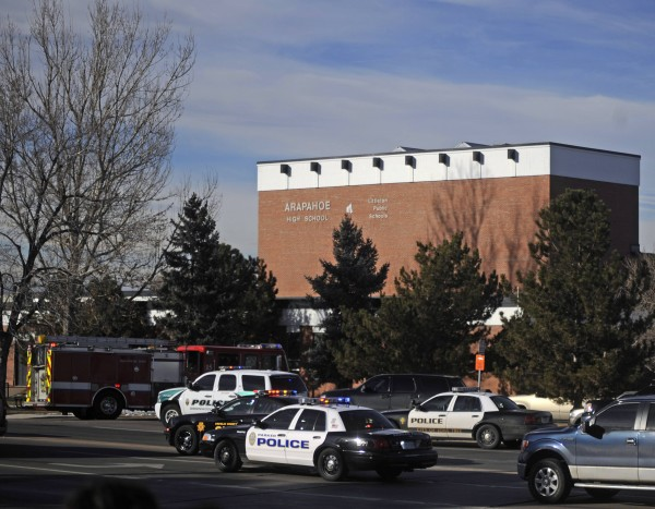 Police and rescue workers arrive at Arapahoe High School, after a student opened fire in the school in Centennial, Colo. on Dec. 13, 2013.