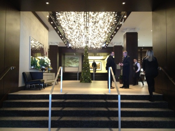 The lobby of the Westin Portland Harborview Hotel is marked by a giant glass chandelier lit with LED lights.