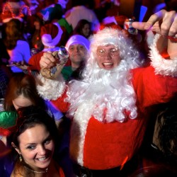 Hundreds hit the streets for Santacon