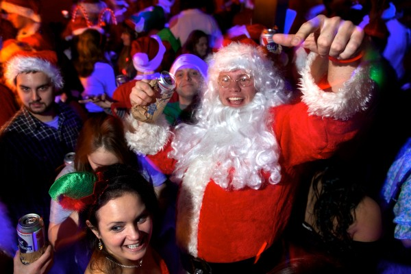 Lee Cannon, one of several hundred people dressed as Santa, elves, reindeer and assorted Christmas characters roaming the streets of Portland's Old Port Saturday night, dances at the Oasis on Wharf Street during an bar-crawl event called Santacon.