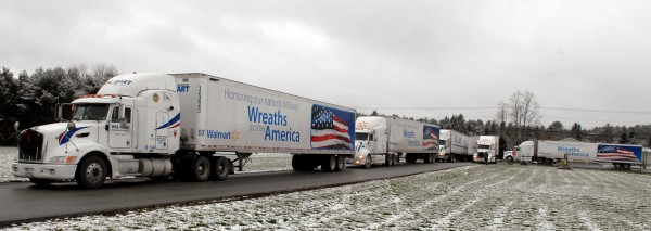 Making their way to Arlington National Cemetery, a convoy of trucks loaded with wreaths, passes by Hermon Elementary School after stopping there for the Wreaths Across America Ceremony in this Dec. 5, 2010 file photo.