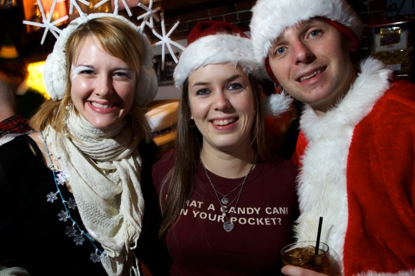 Angela Doxy (from left) Emma Levar and Brett Finegold hang out at Gritty McDuff's on Fore Street in Portland Saturday night during Santacon.