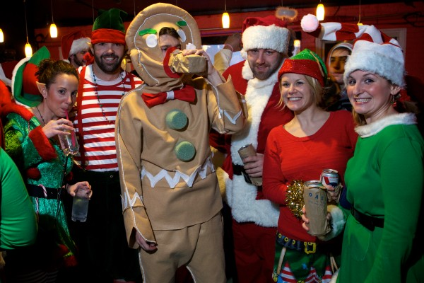 Hundreds of Santas, elves, gingerbread men and the like flowed through Portland's Old Port Saturday night during Santacon.