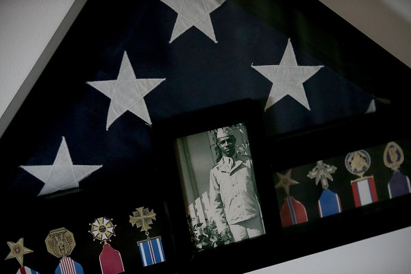 A triangular frame contains a flag and medals awarded to U.S. Army Sgt. Joseph Gantt at the home of his widow, Clara Gantt, in Inglewood, Calif., on Friday, Dec. 20, 2013. Sgt. Gantt served during World War II and the Korean War, and had been listed as missing in action since 1950. Sgt. Gantt's remains were recently identified and returned to Los Angeles on Friday.