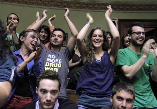 People celebrate after the Senate approved a government-sponsored bill that provides for regulation of the cultivation, distribution and consumption of marijuana during a session in Montevideo December 10, 2013.