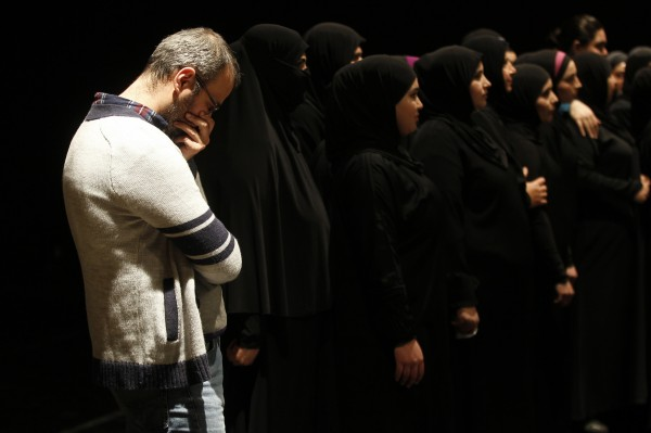 Syrian Director Omar Abu Ssada (L) and Syrian refugee women acknowledge the audience after their play &quotThe Syria Trojan Women&quot in Amman, Jordan, last week.