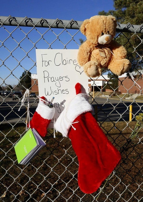 A Christmas stocking and a notebook for prayers for Claire Davis hangs on a fence at Arapahoe high school in Centennial, Colorado December 15, 2013. Davis, a 17-year-old Colorado high school senior shot in the head December 13 by a heavily-armed classmate who stormed the school remained in critical condition, the county sheriff said.