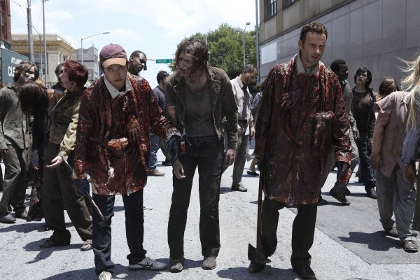 Steven Yeun, left, and Andrew Lincoln, right, trying to blend in with the crowd in &quotThe Walking Dead.&quot