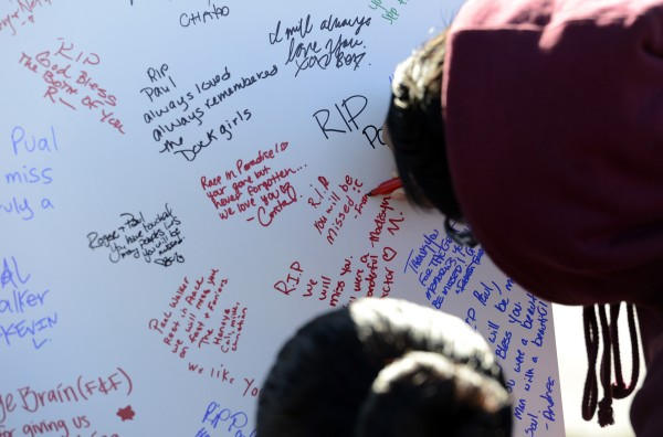 Fans write remembrances at the scene of a fiery crash that killed &quotFast and Furious&quot actor Paul Walker in the Santa Clarita area of Los Angeles on December 1, 2013. Walker died at the scene on Saturday.