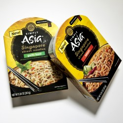 Microwaveable eats dubbed Singapore Street Noodles from Simply Asia. Each bowl includes three packets (rice noodles, sauce, dehydrated vegetables) in garlic basil, kimchi, sesame ginger and classic curry flavors.