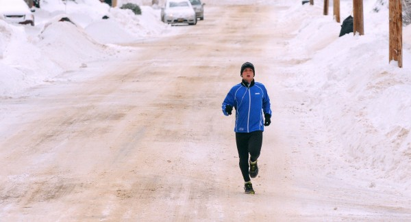 The snow was no obstacle for John Bapst High School track athlete Alex Rockcress as he went on with his regular training routine running through the streets of Bangor on Monday morning.
