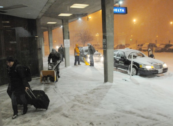 Passengers headed out on departing flights make their way into the terminal at BIA in Bangor during Sunday's snow storm, most arrivals have been cancelled.