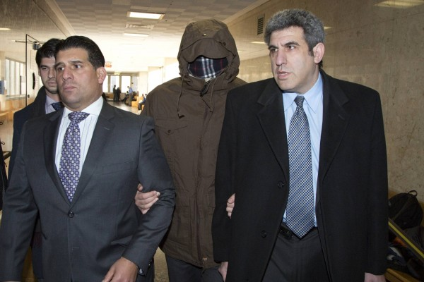 Wojciech Braszczok (center) enters Manhattan Supreme Court in New York on Nov. 20, 2013. Braszczok, an undercover New York police detective, was arraigned on gang assault charges for his part in an attack on an SUV driver that was captured on video and went viral on YouTube. The pack of riders is accused of chasing a Range Rover driven by 33-year-old Alexian Lien on Sept. 29 on Manhattan's Henry Hudson Parkway. The bikers smashed the vehicle's windows, hauled Lien out and beat him, police said.